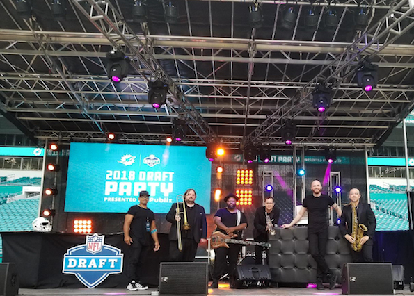 Fusion and DJ Slim Rok onstage at the Miami Dolphins 2018 NFL Draft Party